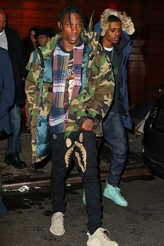 Travis Scott wearing  Adidas Men's Yeezy Boost 350 Oxford Tan, Bape x Dover Shark Denim Jeans, Supreme Uptown Parka 700-Fill Woodland Camo