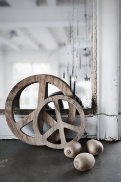 the peace coasters [from recycled teak] that you cleaned out the shop of on opening night [!] is back in stock tonight. wooOooot !! and peace. / the warriors