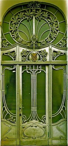 [This looks to me like a transitional style between the super-decorative lines of Art Nouveau and the geometric emphasis of Art Deco.] Green and Art Nouveau. Cool Doors, Unique Doors, The Doors, Windows And Doors, Architecture Art Nouveau, Architecture Details, Amazing Architecture, Art Deco, Art Nouveau Arquitectura