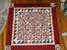 What do I do with all those left over triangles? Make a quilt......