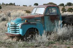 The old blue chevy sits across the highway and it just looks COOL! Photo by CheyAnne newmexicomtngirl on Etsy.