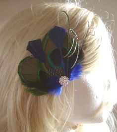 Peacock Feather Hair Clip DIAMOND BLUE Feather with Navy Blue Goose Feathers and Rhinestone Hair Fascinator Clip  Ready to Ship. $20.00, via Etsy.