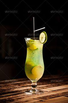 Green alcoholic cocktail ...  alcohol, bar, citrus, cocktail, cold, drink, freshness, fruit, garnish, green, ice, juice, lemon, lime, liquor, reflection, refreshment, rum, soda, straw, sweet, syrup, taste, tropical