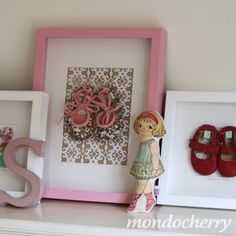 Great way to display baby and children's shoes.  I have a collection of baby shoes that I'd like to frame like this.