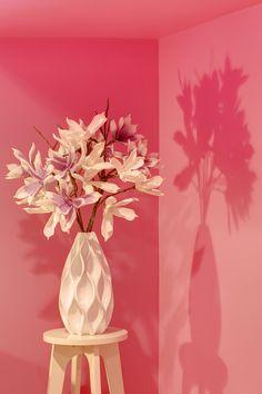 Bella Fiore Spa. Decorative flowers in a unique vase add vibrancy to an unused corner. #interiordesign #seattle #flowers #shadows #whitevase