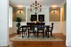greek design influence... this dining room is inspired by greek design because the chairs resemble the Klismos chair