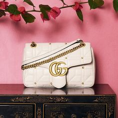 """Gucci matelass leather shoulder bag with a cubic pattern and studs. Antiqued golden hardware. Sliding chain strap can be doubled, 11.8""""-21.5"""" drop. Flap top with interlocking GG push-lock clasp. Interior, microfiber lining; one zip and one slip pocket. 7.5""""H x 12.3""""W x 2.8""""D. """"GG Marmont 2.0"""" is made in Italy.  MATELASSE LEATHER guccifw16 nmhandbags Women alessandromichele WHITE gucci The moment we saw this studded Marmont shoulder bag, it was love at first sight. Link in bio to shop…"""