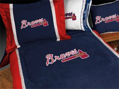"Atlanta Braves MVP Comforter by Sports Coverage. $75.23. This Locker Room Atlanta Braves MVP Comforter is made of 100% polyester jersey that stays colorfast, soft, and wrinkle free, allowing your bedroom to suit up like a pro!  The generous-sized comforters at 66"""" x 86"""" (twin) and 86"""" x 86"""" (full/queen) are filled with 100% bonded polyester batting and reverse to a gray and white cotton blend NFL print to give your athlete full coverage."