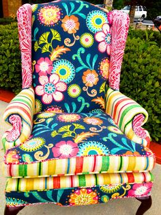 A gorgeous, unique wingback chair with a retro theme! The most unique feature about this one of a kind piece is the seat cushion is double sided. One side has a white and red fabric, flip it over and the other side has a multi colored fabric that matches the front and back of the chair. Truly, a piece of art! Flower print wingback chair by EmileyMichelle on Etsy, $675.00