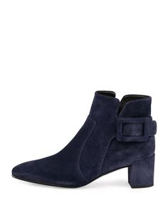 """Roger Vivier ankle boot with suede upper. 2.3"""" covered block heel; 7""""H shaft, 8"""" top circumference. Almond toe. Layered vamp with tonal topstitching. Signature buckle detail. Collar dips at sides. Pul"""