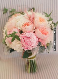 Pink and peach color scheme for tables , and bridesmaids, and my bouquet,also for boutonniers (sorry sis! They need pops of color on thier all gray tuxes!!)