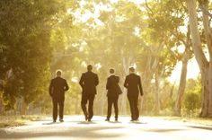 Groomsmen walking along a gumtree lined road Location ~ Kings Park, Perth Photography by DeRay & Simcoe