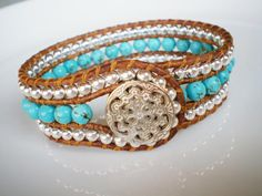 Turquoise Jewelry Cuff Bracelet Leather Cuff Turquoise Beaded Cuff Wrap Bracelet Stunning little piece features high quality turquoise magnesite and high quality durable sterling silver plated metal round beads. Beads are sewn onto natural leather and a filigree silver tone button finishes the piece for one that is sophisticated upscale southwestern and will go with many day and evening ensembles, and will kill with jeans and a T. (sold out? Check out this similar style…