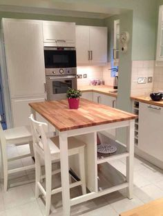 Image from http://www.marksci2013.com/wp-content/uploads/2015/01/kitchen-island-with-seating-butcher-block.jpg.