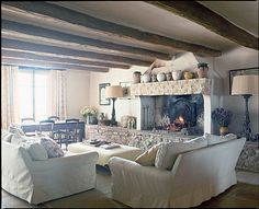 i love the feeling in this room... what a GREAT fireplace and mantle and exposed beams perfectly decorated..