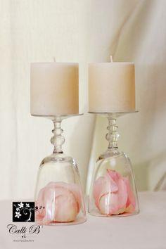 Upside down wine glasses make candle holders.