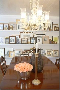 Ledges for framed photos on dining room wall. India Hicks and David Woods.