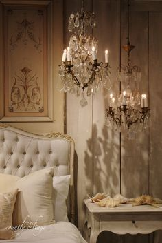Vintage French Soul ~ I'm in love with the idea of two mini chandeliers hung together for impact.  the shadows set such a lovely mood.