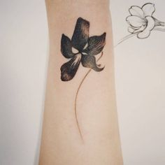 Manchurian violet flower tattoo on the forearm. Tattoo artist:...
