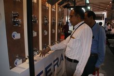 Visitors at #CREDAI #GUJCON2015 taking a look at the #CERA products. #reflectsmystyle