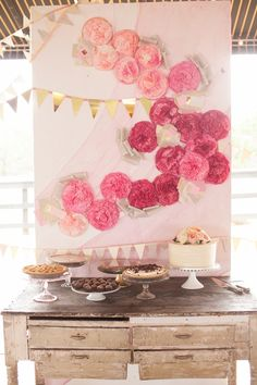 backdrop with a swoop of tissue flowers