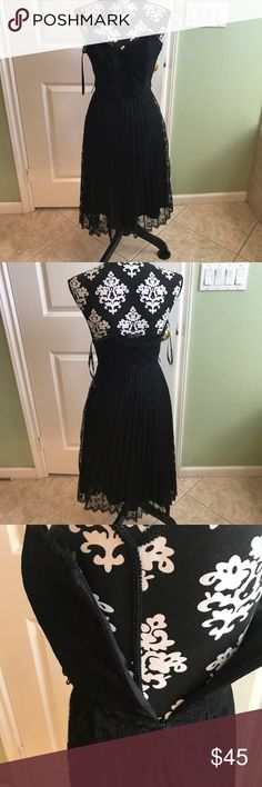 Betsey Johnson Sexy Goth Laced Strapless Dress This sexy dress is perfect for any occasion has a side zipper great pre loved condition no rips stains or tears just misplaced the matching belt that went with it but it looks great without it and you can add your own style to it Betsey Johnson Dresses Midi