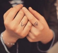 Peace heart finger tattoo