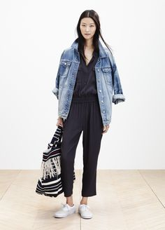 Madewell oversized jean jacket worn with the Pull-On jumpsuit + woven beach tote.