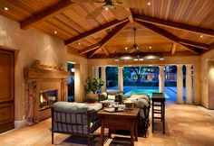 Partially enclosed cabana with vaulted mahogany ceiling, built-in heaters, fireplace, and barbecue kitchen.  #cabana