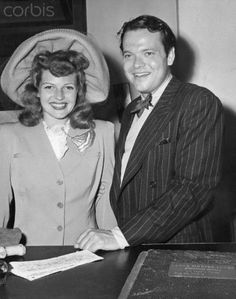 Rita Hayworth and Orson Welles sign their marriage license in 1943. Description from cometoverhollywood.com. I searched for this on bing.com/images