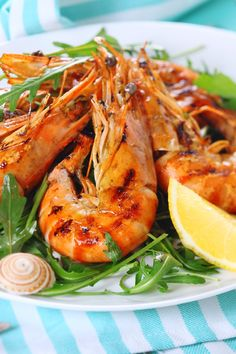 Recipe including course(s): Entrée; and ingredients: black pepper, garlic, ginger, green onion, lime juice, peanut oil, shallot, shrimp , soy sauce, sugar