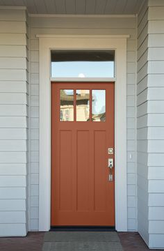 Dreaming of a red front door but hoping for something a little more subdued? Consider a terra-cotta shade, such as Cavern Clay by Sherwin-Williams, to brighten up the exterior of your home. Coral Front Doors, Best Front Door Colors, Best Front Doors, Front Door Paint Colors, Best Paint Colors, Painted Front Doors, Colored Front Doors, Colored Door, Orange Paint Colors