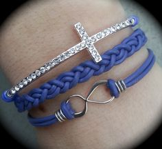 Purple leather wrap bracelet with cross and infinity pendant made by Dizzy Bees. Search Dizzy Bees on Facebook.
