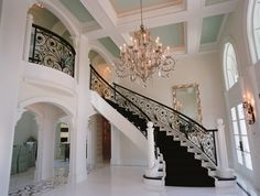 Black and white Mediterranean staircase design in this luxury home in Chicago