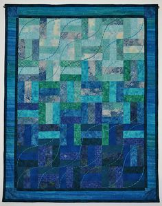 Quilt by bbgailes, via Flickr - An easy rail fence pattern - but the colors really make this a beautiful quilt!!