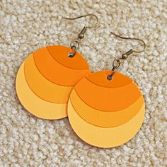 DIY earrings from paint chips. You could make so many colors. Even rainbow.
