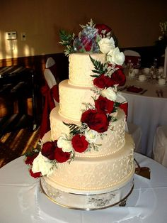 Ivory Wedding Cake with Red Roses, instead of white roses i'd do a green accent