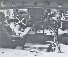 Inside a German Tiger tank, the drivers sitting his assigned position....