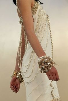 LoLoBu. Absolutly loving the idea! Pearls and swarowski would make the perfect simple wedding dress
