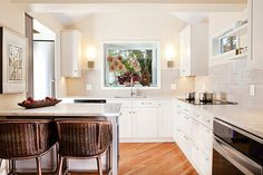 A kitchen with marble counters