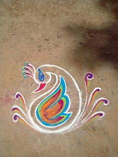 Peacock Rangoli Rangoli Border Designs, Small Rangoli Design, Rangoli Patterns, Colorful Rangoli Designs, Rangoli Ideas, Rangoli Designs Diwali, Rangoli Designs Images, Kolam Rangoli, Beautiful Rangoli Designs