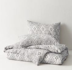 RH TEEN's Washed Ikat Medallion Duvet Cover:Soft linen-cotton – known for its textural hand and relaxed drape – exquisitely printed with an oversized ikat pattern in rich tonal shades.
