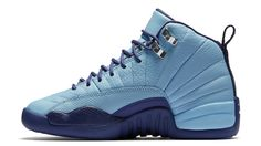 "The Air Jordan 12 takes inspiration from the Michael Jordan-owned Charlotte Hornets for the release of the Air Jordan 12 Retro GS ""Hornets."" The GS-exclusive release, the sneaker features a mix of blue cap on the textured leather upper with metallic silver and dark purple dust accents. Release date is Oct. 8, 2016 at a retail price of $140."