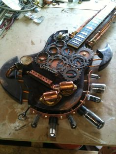 A steampunk inspired guitar sculpture i did for a charity auction.