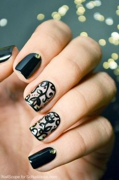 Wonderful black colored flora nail polish. Take a look at this lovely black against clear polish combination in floral design. Simple yet elegant looking nail art. source