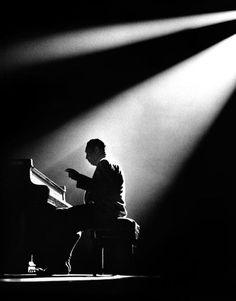 Duke Ellington by Herman Leonard    1958: Duke Ellington plays the piano at the Olympia Theater in Paris.