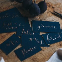 navy and copper or gold calligraphy wedding place card by kayleigh tarrant | notonthehighstreet.com