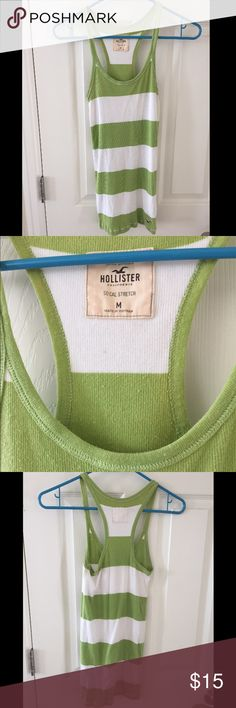 "Hollister striped tank top Holister size M ""socal stretch"" green and white stripe ribbed tank top. 93% cotton, 7% elastane. Slight pilling as shown by third picture, but otherwise in great condition. Hollister Tops Tank Tops"