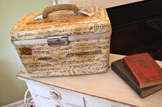 DIY: Covering suitcases/containers with old sheet music + modge podge