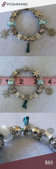 X-Small Disney Frozen Princess Elsa Charm Bracelet EXTRA SMALL - Child size charm bracelet  This bracelet is meant for a kindergarten age child. It is only 6 inches (15cm) EMPTY...When full with charms it is much smaller. It has 6 spacers which could be removed to adjust size to fit looser.  Light Blue Braided PU Leather, Silver Plate Lobster Clasp Bracelet.  21 Charms in total  Comes in a large cream color anti-tarnish plush drawstring jewelry pouch, wrapped in tissue paper; great for…